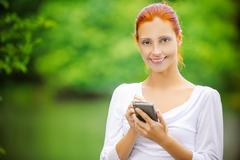 Woman writes stylus on screen of device Stock Photos