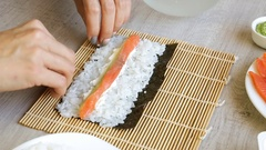 Making sushi woman roll Stock Footage