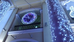 In the New Year's Eve Christmas clock chimes at Gostiny Dvor flashing lights. Stock Footage