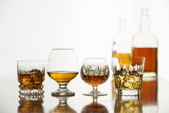 Alcoholic drinks in jars with bottles Stock Photos