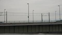 4K Public transportation in Koln town tramway car cross bridge commuter travel Stock Footage