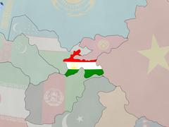 Tajikistan with flag in rising sun with flag on globe Stock Illustration