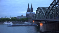 4K Beautiful Koln cathedral and Hohenzollern bridge at twilight ship sail river Stock Footage