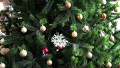 Garlands and snowflake lights on a Christmas tree holiday Stock Footage