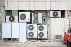 Air conditioner compressors on the street Stock Photos