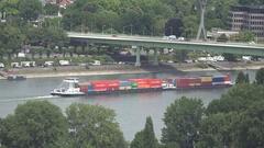 4K Aerial view public transport in Koln cargo ship sail traffic car on bridge Stock Footage