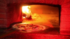 Pizza into brick oven Stock Footage