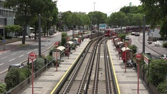 4K Aerial view heavy traffic in Koln city car pass tramway arrive in station day Stock Footage