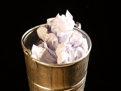 Put Crumpled papers in a turning metal basket Stock Footage