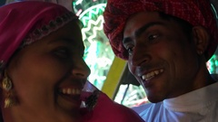 Indian couple enjoying ferris wheel ride in traditional dresses at the Pushkar M Stock Footage