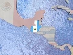 Guatemala with flag on globe Stock Illustration