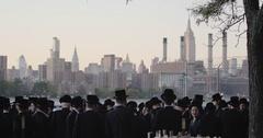 Hasidic Jews gathering at the Brooklyn waterfront during the Rosh Hashanah - 4k Stock Footage