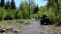 Quad bike and motorcycle rides through countryside Stock Footage