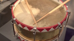 Old vintage unique colorful snare drum with drumsticks, close up, shallow DOF Stock Footage