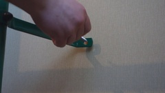 Hand spins into the wall screw Stock Footage