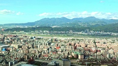 Landscape of Taipei City, there are mountains on the horizon. 4K Stock Footage