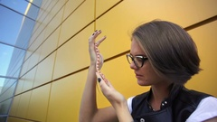 Fascinating young girl posing with a snake on the street Stock Footage