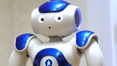 Blue humanoid robot nao moving Stock Footage