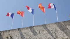 Flags of France and Normandy in city center castle Stock Footage