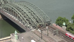 4K Aerial view famous Hohenzollern bridge icon in Koln local train pass commuter Stock Footage