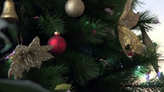 Christmas festive fir tree decorated with garlands and colored balls Stock Footage