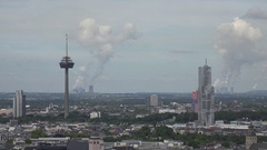 4K Aerial view Koln crowded suburban area industrial chimney air pollution smog Stock Footage