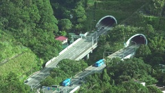 Tunnels through the mountains in Taipei, there is much vegetation around. 4K Stock Footage