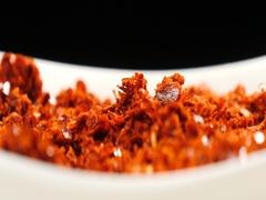 Falling chilli powder on a dish Stock Footage