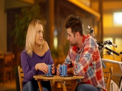 Hipster white couple sitting at a nice cafe by the beach drinking coffee Stock Footage