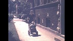 Vintage 16mm film, 1940 Americana, mom baby stroller, happy family Stock Footage