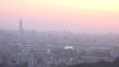 Sunset at skyline of Taipei with the Taipei 101, a plane is taking off, Pan. 4K Stock Footage