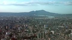 Landscape of Taipei City, there are mountains on the horizon, Zoom in. 4K Stock Footage