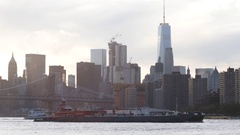 A ship passes in front of NYC's World Trade Center in the East River Stock Footage