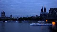 4K Timelapse cruise ship sail on river Koln city skyline famous tourist emblem Stock Footage