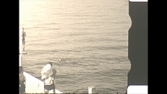 Vintage 16mm film, 1940 Americana, people jumping in lake, high angle Stock Footage