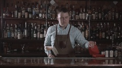 Young barman worker at bartender desk serving cocktail in restaurant bar Stock Footage