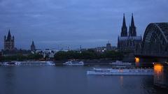 4K Panoramic view Koln town at twilight touristic boat sail Rhine River church Stock Footage