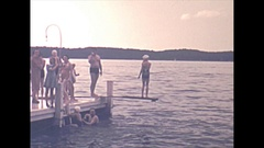 Vintage 16mm film, 1940 Americana, girl jumping in lake, swimming Stock Footage