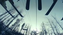 4K footage: Skiers' ski on the moving lift Stock Footage