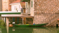 Boat moored on the doorstep of the house in flooded area after heavy rain Stock Footage