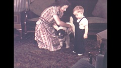 Vintage 16mm film1940 Americana, children and pet dog playing in the living room Stock Footage