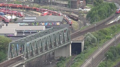 4K Aerial view local train departure Koln city commuter railway transportation Stock Footage