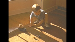 Vintage 16mm film, 1940 Americana, toddler playing, nice light Stock Footage