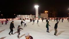 People skate on the skating rink in the park Sokolniki Stock Footage