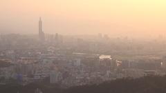 Skyline at sunset of Taipei City with the Taipei 101, Pan. 4K Stock Footage