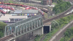 4K Timelapse busy railway infrastructure in Koln local train transit people trip Stock Footage