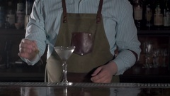Barman at work, preparing cocktails. pouring pina colada to cocktail glass Stock Footage