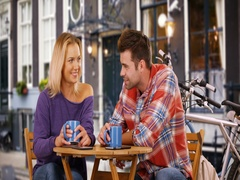 Pretty young woman answers phone call in the middle of her date Stock Footage