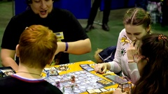 Cosplayers playing table game at the Gamefilmexpo festival Stock Footage