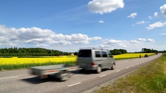 A scenic road through a rapeseed field in Sweden. Stock Footage